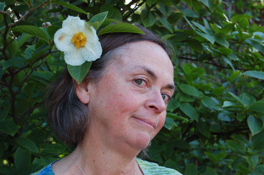 nancy buley at treephoria with stewartia flower in her hair