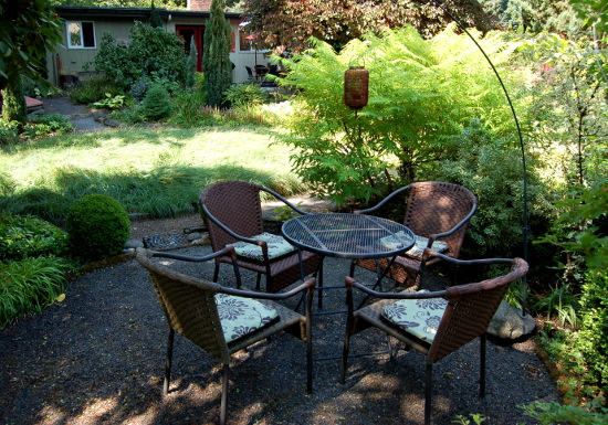 sitting area in garden of vanessa gardner nagel