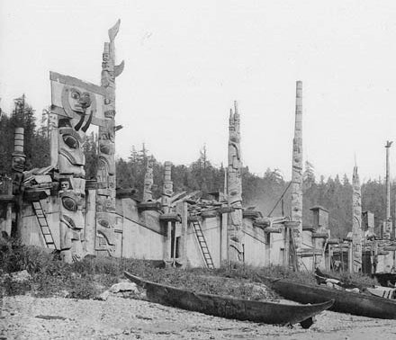 Haida houses and totem poles.